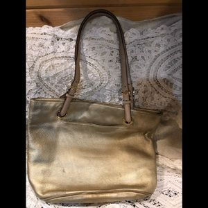 MK gold leather purse